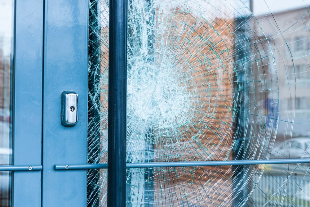 Broken glass door Miami